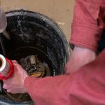 Clean a sump pump